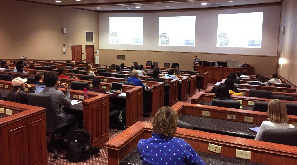 Photo of seminar speaker in auditorium